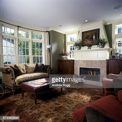 Living Room With Bay Window And A Stone Fireplace Stock Photo