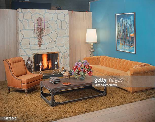Living room with fireplace in background