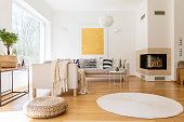 Spacious white and wooden living room with modern fireplace and sofa