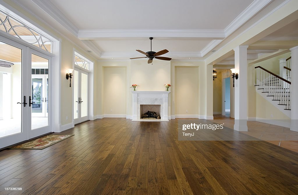 Living Room With No Furniture And Wooden Floors