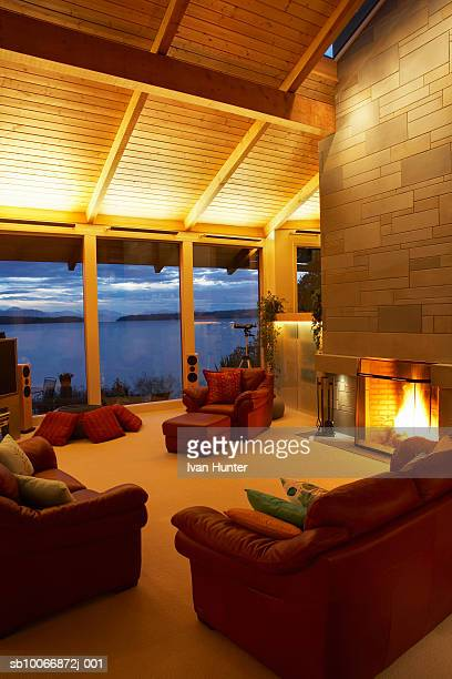 Living room with open fireplace and view over bay