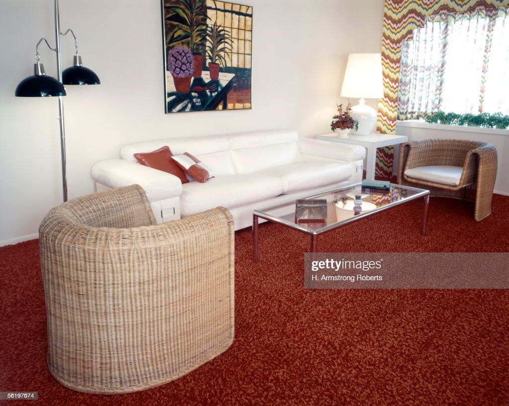 Living Room With Sofa, 2 Wicker Chairs, Glass Coffee Table, Couch, Home D?cor, And Interior Design Furniture.