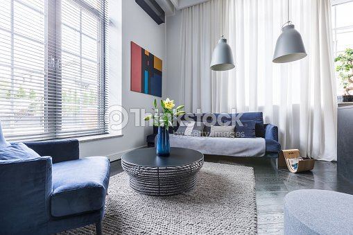Living room with upholstered furniture : Stock Photo