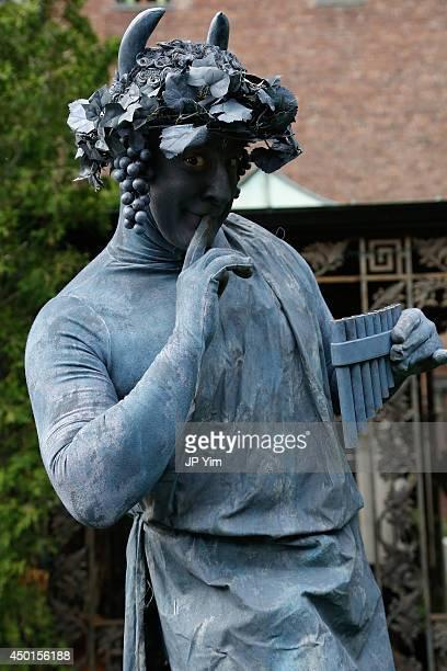 'Living statue' Peter Engel poses at the Stella McCartney Spring 2015 Presentation at Elizabeth Street Gardens on June 5 2014 in New York City