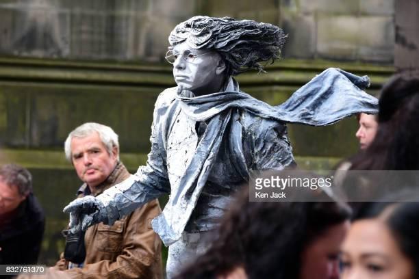 A 'living statue' street performer on the Royal Mile during the Edinburgh Festival Fringe on August 16 2017 in Edinburgh Scotland The Fringe is...