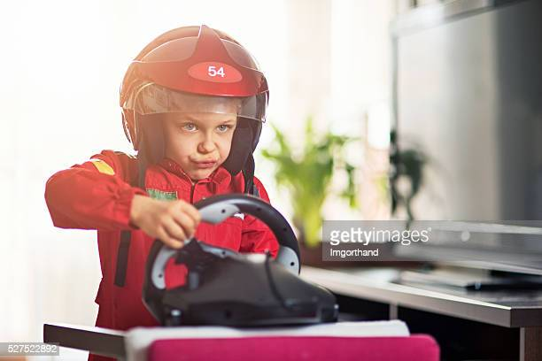 Livingroom race - little boy pretending to ride race car
