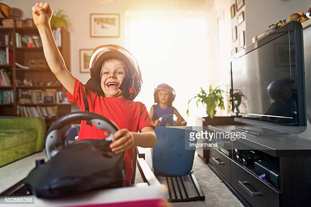 Livingroom race - little boys pretending to ride race cars