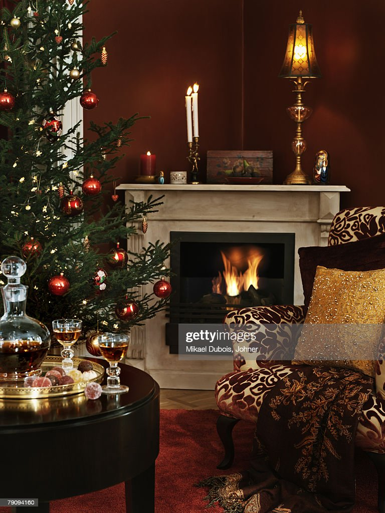 livingroom with a fireplace and a christmas tree stock photo