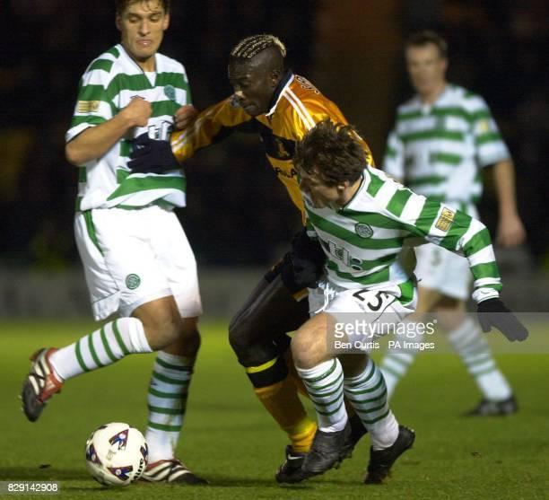 Livingston's Cherif Toure Maman battles with Celtic's Lubomir Moravcik and Stilian Petrov at the Livingston v Celtic quarterfinal match in the CIS...