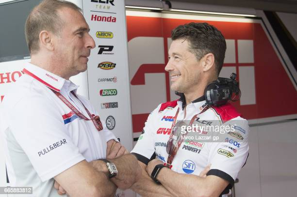 Livio Suppo of Italy and Repsol Team Honda speaks with Lucio Cecchinello of Italy and LCR Honda MotoGP in front of box during the MotoGp of Argentina...