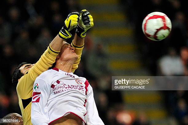 Livorno defender Romano Perticone jumps to save a ball with Livorno goalkeeper Rubinho the Series A football match Inter Milan vs Livorno at San Siro...