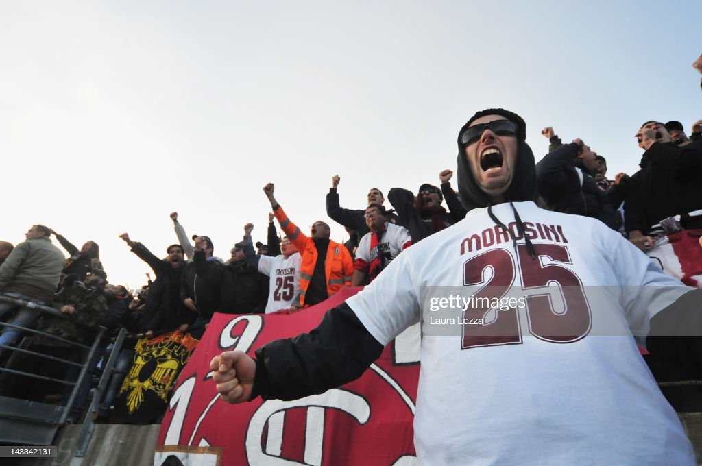 Livorno fans wear jerseys bearing the number 25 as they pay tribute to Piermario Morosini during the Serie B match between AS Livorno and AS...
