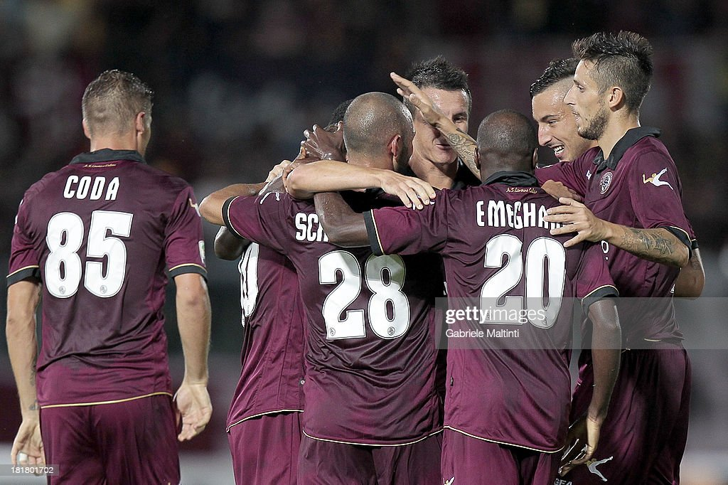 Livorno players celebrate a goal scored by Andrea Luci during the Serie A match between AS Livorno and Cagliari Calcio at Stadio Armando Picchi on September 25, 2013 in Livorno, Italy.