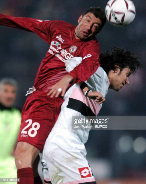 Livorno's Passoni battles for possession of the ball in the air with Palermo's Zaccardo
