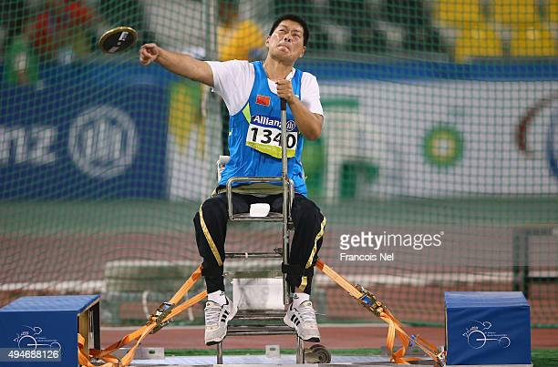 Liwan Yang of China competes in the women's discus F55 final during the Evening Session on Day Seven of the IPC Athletics World Championships at...