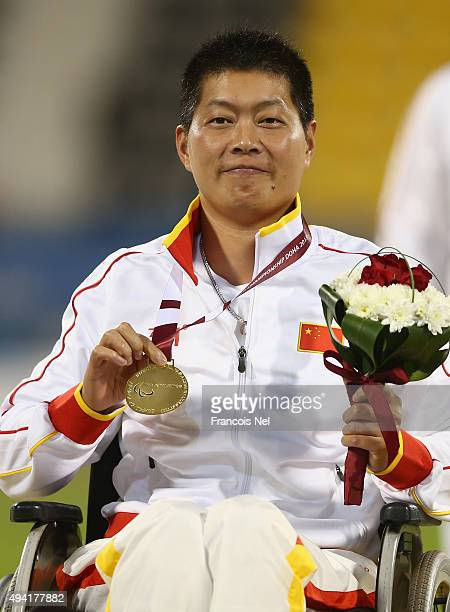 Liwan Yang of China poses with her gold medal after the women's shot put F54 final during the Evening Session on Day Four of the IPC Athletics World...