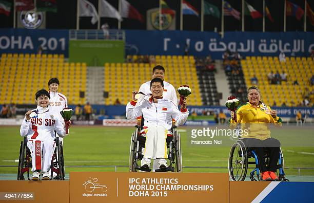 Liwan Yang of China poses with her gold medal Maria Bogacheva of Russia silver and Elizabeth Gomes of Brazil bronze after the women's shot put F54...