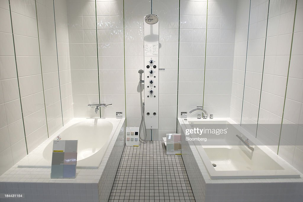 Lixil Group Corp.'s bathtubs and shower units sit on display at the company's showroom in Tokyo, Japan, on Friday, Oct. 11, 2013. Lixil and Development Bank of Japan agreed on Sept. 26 to buy bathroom-fixtures maker Grohe Group, valuing the German company at 3.06 billion euros ($4.1 billion). Photographer: Kiyoshi Ota/Bloomberg via Getty Images