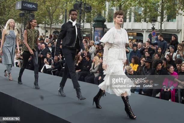 Liya Kebede Maria Borges and Barbara Palvin walk the runway during the Le Defile L'Oreal Paris Spring Summer 2018 show as part of Paris Fashion Week...