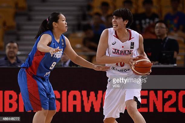 LiYun Wang of Chinese Taipei vies with Ramu Tokashiki of Japan in semifinal match between Japan and Chinese Taipei during the 2015 FIBA Asia...