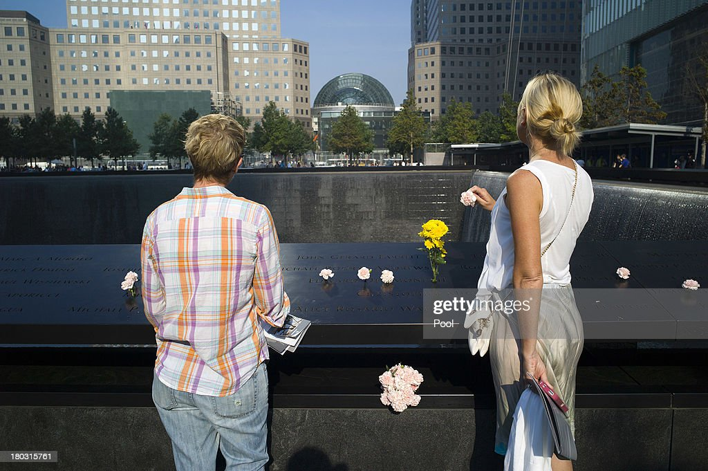 Liz Breslin (R) and Mary Beth Andrews stand by the inscription of Breslin's boyfriend and Andrews's brother Cantor Fitzgerald employee Michael Rourke Andrews at the 9/11 Memorial before ceremonies for the 12th anniversary of the terrorist attacks on lower Manhattan at the World Trade Center site on September 11, 2013 in New York City. The nation is commemorating the anniversary of the 2001 attacks, which resulted in the deaths of nearly 3,000 people after two hijacked planes crashed into the World Trade Center, one into the Pentagon in Arlington, Virginia and one crash landed in Shanksville, Pennsylvania. Following the attacks in New York, the former location of the Twin Towers has been turned into the National September 11 Memorial & Museum.