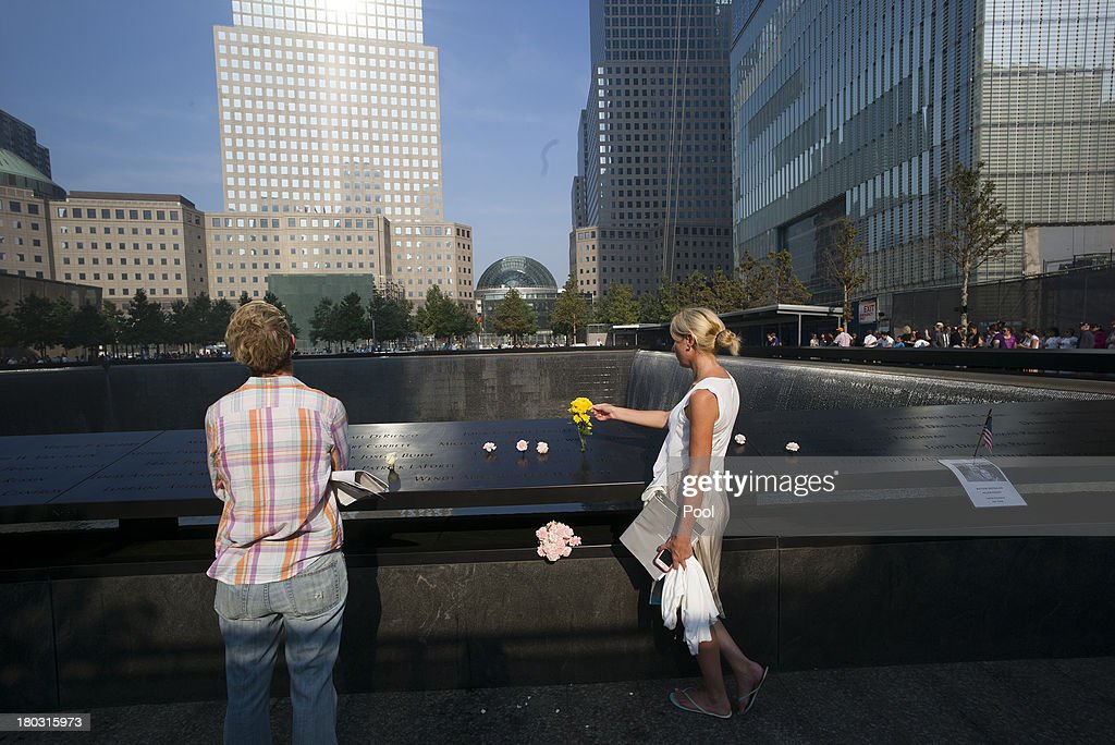 Liz Breslin (R) and Mary Beth Andrews stand by the inscription of Breslin's boyfriend and Andrews's brother Cantor Fitzgerald employee Michael Rourke Andrews at the 9/11 Memorial during ceremonies for the 12th anniversary of the terrorist attacks on lower Manhattan at the World Trade Center site on September 11, 2013 in New York City. The nation is commemorating the anniversary of the 2001 attacks, which resulted in the deaths of nearly 3,000 people after two hijacked planes crashed into the World Trade Center, one into the Pentagon in Arlington, Virginia and one crash landed in Shanksville, Pennsylvania. Following the attacks in New York, the former location of the Twin Towers has been turned into the National September 11 Memorial & Museum.