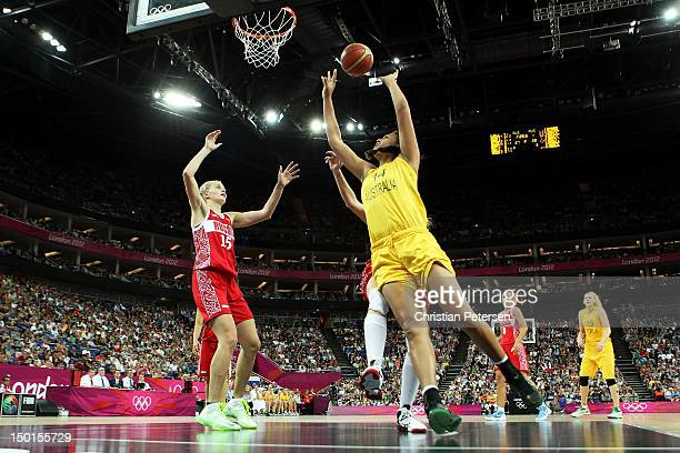 Liz Cambage of Australia attempts a shot in the first half against Nadezhda Grishaeva of Russia during the Women's Basketball Bronze Medal game on...