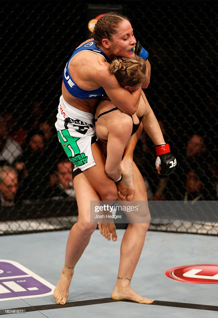 Liz Carmouche (top) attempts to submit Ronda Rousey in their women's bantamweight title fight during UFC 157 at Honda Center on February 23, 2013 in Anaheim, California.