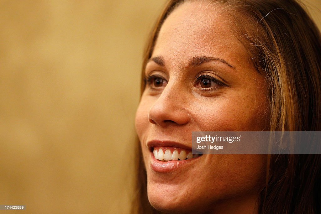 <a gi-track='captionPersonalityLinkClicked' href=/galleries/search?phrase=Liz+Carmouche&family=editorial&specificpeople=7139916 ng-click='$event.stopPropagation()'>Liz Carmouche</a> interacts with media at The Westin Seattle hotel on July 25, 2013 in Seattle, Washington.