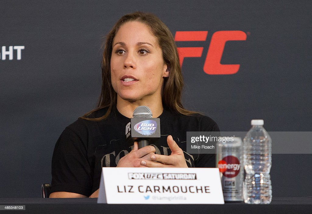 <a gi-track='captionPersonalityLinkClicked' href=/galleries/search?phrase=Liz+Carmouche&family=editorial&specificpeople=7139916 ng-click='$event.stopPropagation()'>Liz Carmouche</a> interacts with media during the FOX UFC Saturday pre-fight press conference at Shaquille O'Neal's estate on April 17, 2014 in Orlando, Florida.