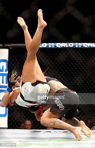 Liz Carmouche of the United States fights against Katlyn Chookagian of the United States in their women's bantamweight bout during the UFC 205 event...