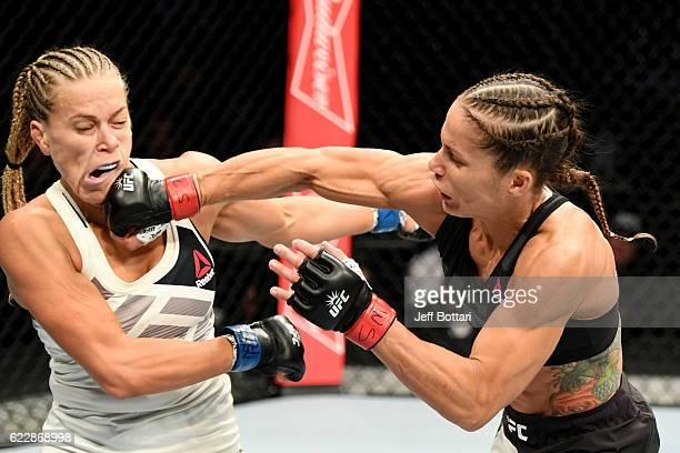 Liz Carmouche of the United States lands a punch on Katlyn Chookagian of the United States in their women's bantamweight bout during the UFC 205...