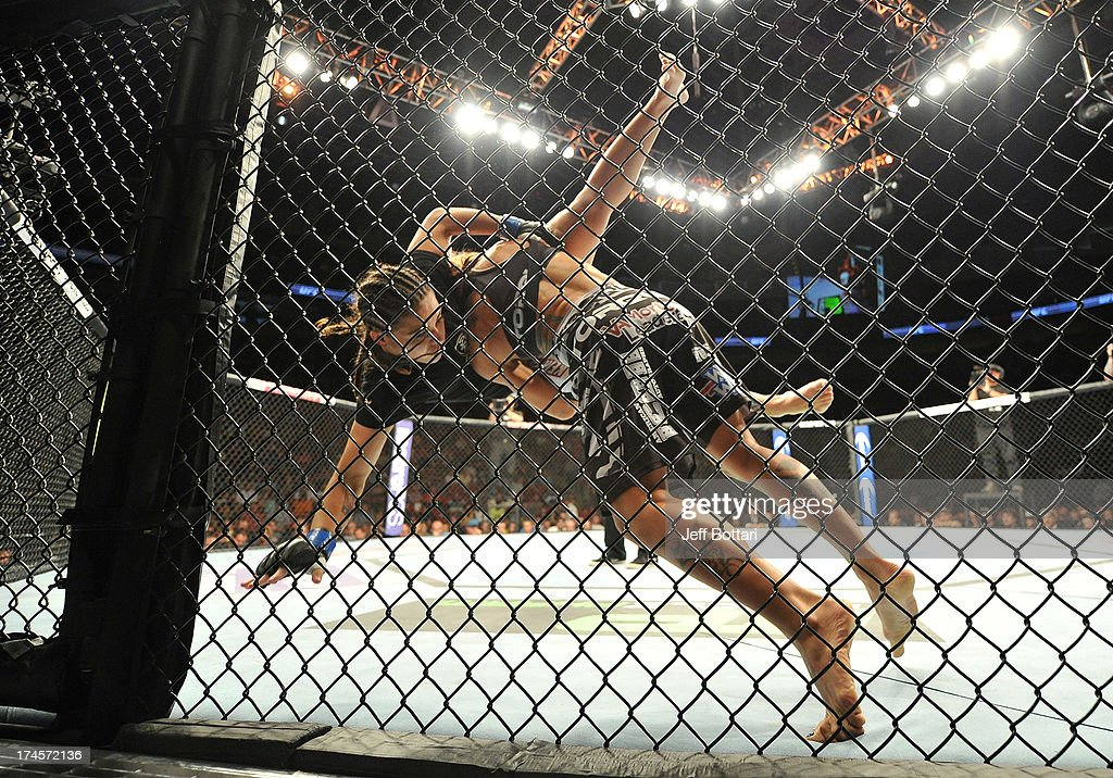 <a gi-track='captionPersonalityLinkClicked' href=/galleries/search?phrase=Liz+Carmouche&family=editorial&specificpeople=7139916 ng-click='$event.stopPropagation()'>Liz Carmouche</a> (right) slams Jessica Andrade during their bantamweight bout during the UFC on FOX event at Key Arena on July 27, 2013 in Seattle, Washington.