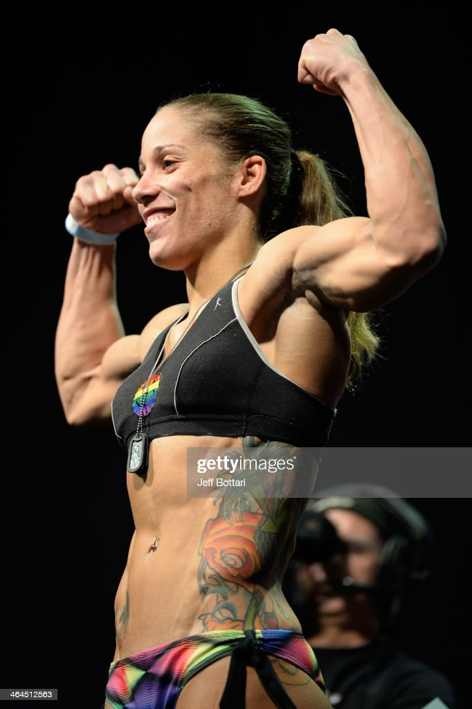 <a gi-track='captionPersonalityLinkClicked' href=/galleries/search?phrase=Liz+Carmouche&family=editorial&specificpeople=7139916 ng-click='$event.stopPropagation()'>Liz Carmouche</a> steps on the scale during the UFC Fight For the Troops weigh-in at the Fort Campbell Sabre Air Field hanger on November 5, 2013 in Fort Campbell, Kentucky.