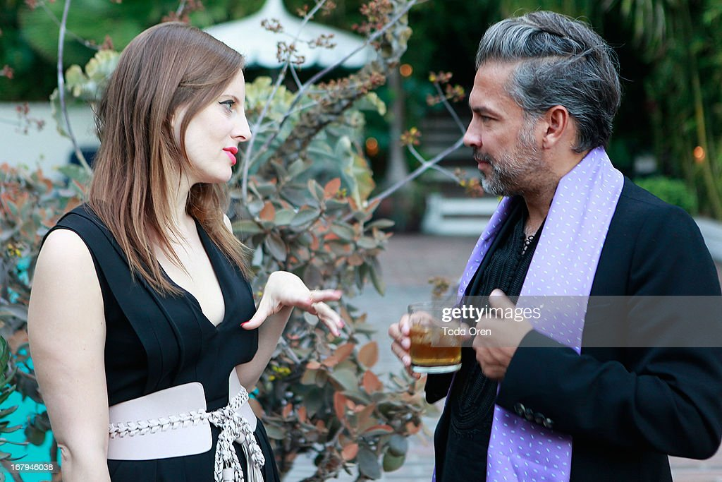 Liz Goldwyn and Carlos Mota talk at the Balmain LA Dinner at Chateau Marmont on May 2, 2013 in Los Angeles, California.