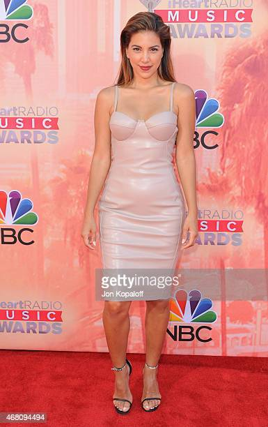 Liz Hernandez arrives at the 2015 iHeartRadio Music Awards at The Shrine Auditorium on March 29 2015 in Los Angeles California