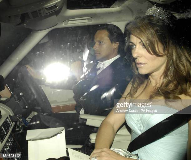 Liz Hurley and Arun Nayar arrive for the White Tie and Tiara Ball hosted by Elton John and David Furnish near Windsor in Berkshire