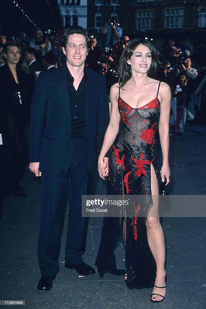 Liz Hurley and Hugh Grant during 'Notting Hill' - London Premiere - Arrivals at Leicester Square in London, Great Britain.