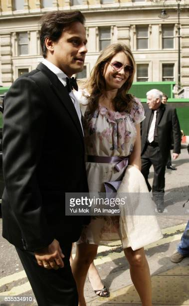 Liz Hurley and husband Arun Nayar arrive at One Whitehall Place in central London for the wedding of Patsy Kensit and Jeremy Healy