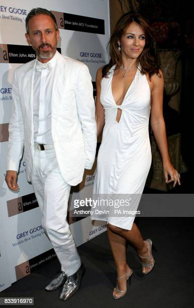 Liz Hurley and Patrick Cox arrive at the Grey Goose Vodka and The Elton John AIDS Foundation VIP launch party One Piazza Covent Garden London