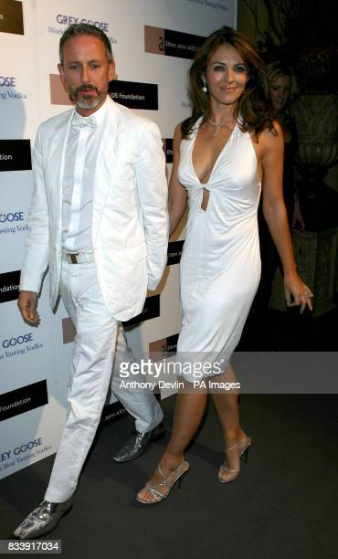 Liz Hurley and Patrick Cox arrives at the Grey Goose Vodka and The Elton John AIDS Foundation VIP launch party One Piazza Covent Garden London
