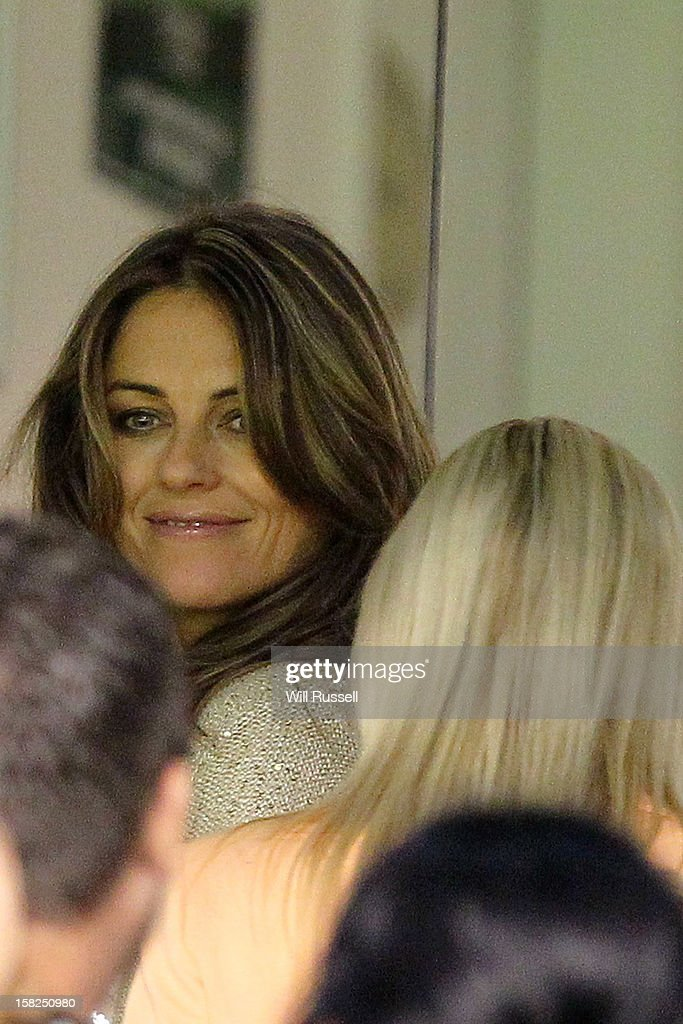 Liz Hurley waits for partner Shane Warne after the Big Bash League match between the Perth Scorchers and the Melbourne Stars at WACA on December 12, 2012 in Perth, Australia.