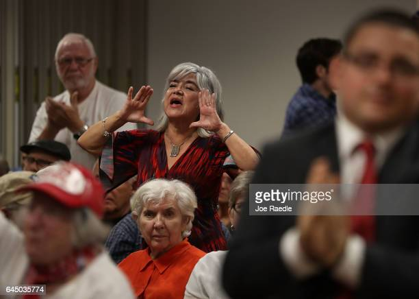 Liz Kenall speaks as she disagrees with Rep Brian Mast during a town hall meeting at the Havert L Fenn Center on February 24 2017 in Fort Pierce...