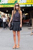 Liz McBridge wears a HM top Corky's shoes Marc Jacobs bag and RayBan sunglasses in June 2012 in New York City