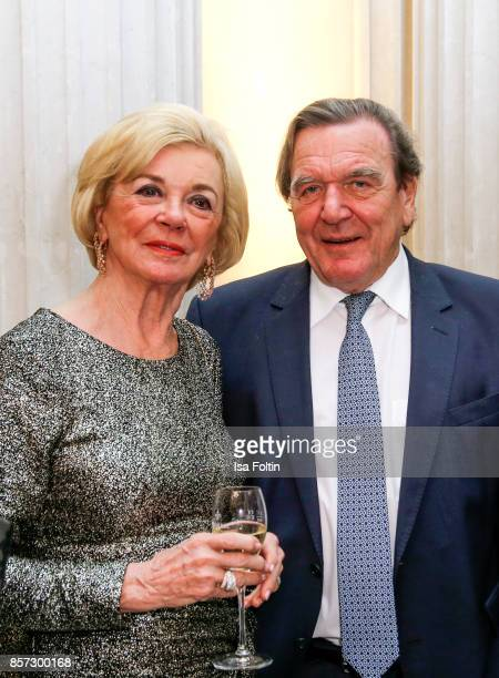 Liz Mohn and former German chancellor Gerhard Schroeder during the ReOpening of the Staatsoper Unter den Linden on October 3 2017 in Berlin Germany