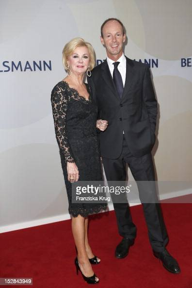 Liz Mohn and Thomas Rabe attend the Bertelsmann Summer Reception on September 27 2012 in Berlin Germany