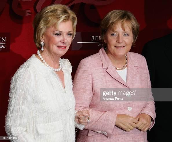Liz Mohn vicechair of the Bertelsmann Stiftung Executive Board and German Chancellor Angela Merkel attend the annual Bertelsmann party on September...