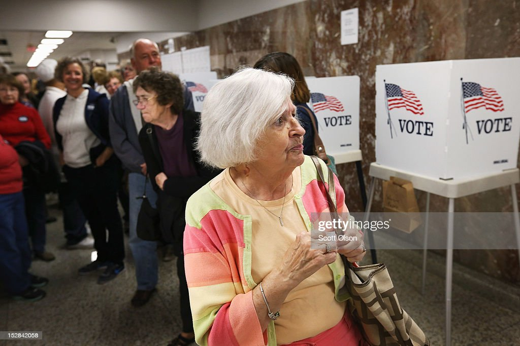 Liz Poole, whose first experience with politics was campaigning for FDR as a child, waits in line to pick up a ballot during early voting at the Black Hawk County Courthouse on September 27, 2012 in Waterloo, Iowa. Early voting starts today in Iowa where in the 2008 election 36 percent of voters cast an early ballot.