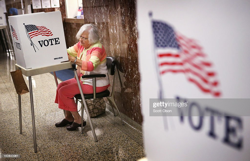 Liz Poole, whose first experience with politics was campaigning for FDR as a child, fills in her ballot during early voting at the Black Hawk County Courthouse on September 27, 2012 in Waterloo, Iowa. Early voting starts today in Iowa where in the 2008 election 36 percent of voters cast an early ballot.