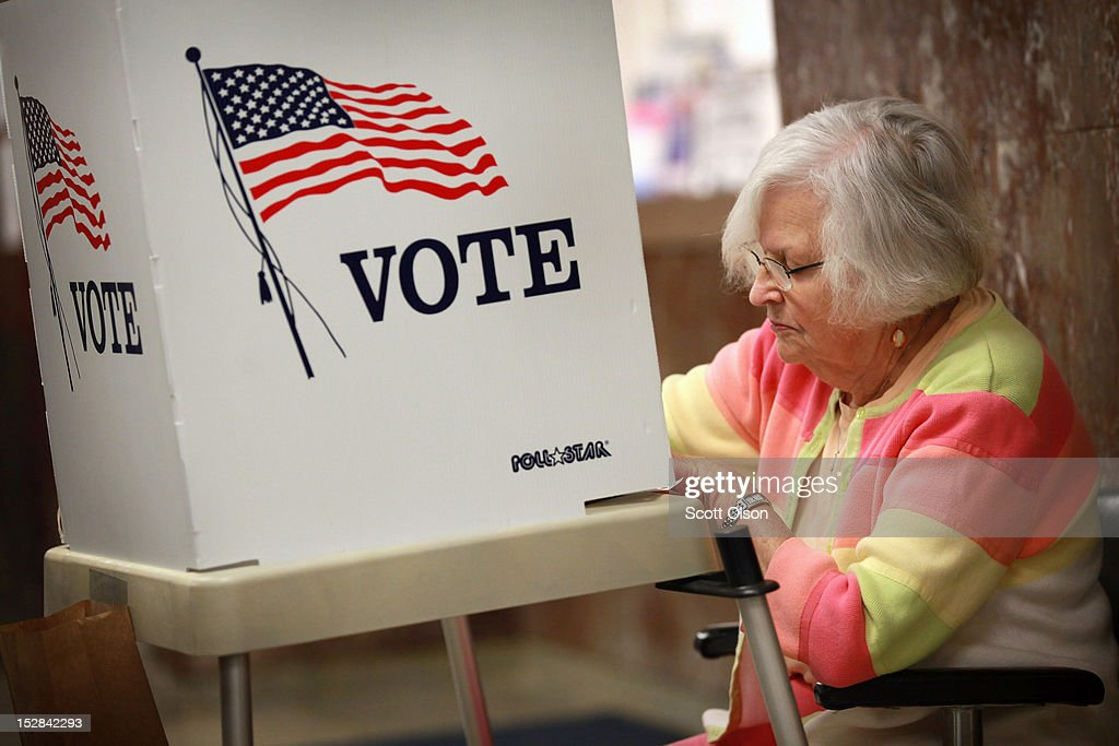 Liz Poole, whose first experience with politics was campaigning for President Franklin D. Roosevelt as a child, fills in her ballot during early voting at the Black Hawk County Courthouse on September 27, 2012 in Waterloo, Iowa. Early voting starts today in Iowa where in the 2008 election 36 percent of voters cast an early ballot.